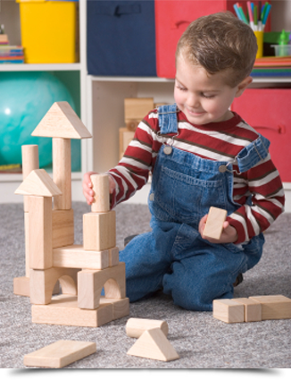 Young boy building toy blocks||||