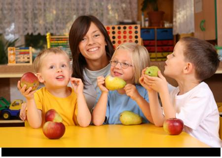 Preschoolers having break for fruits||||