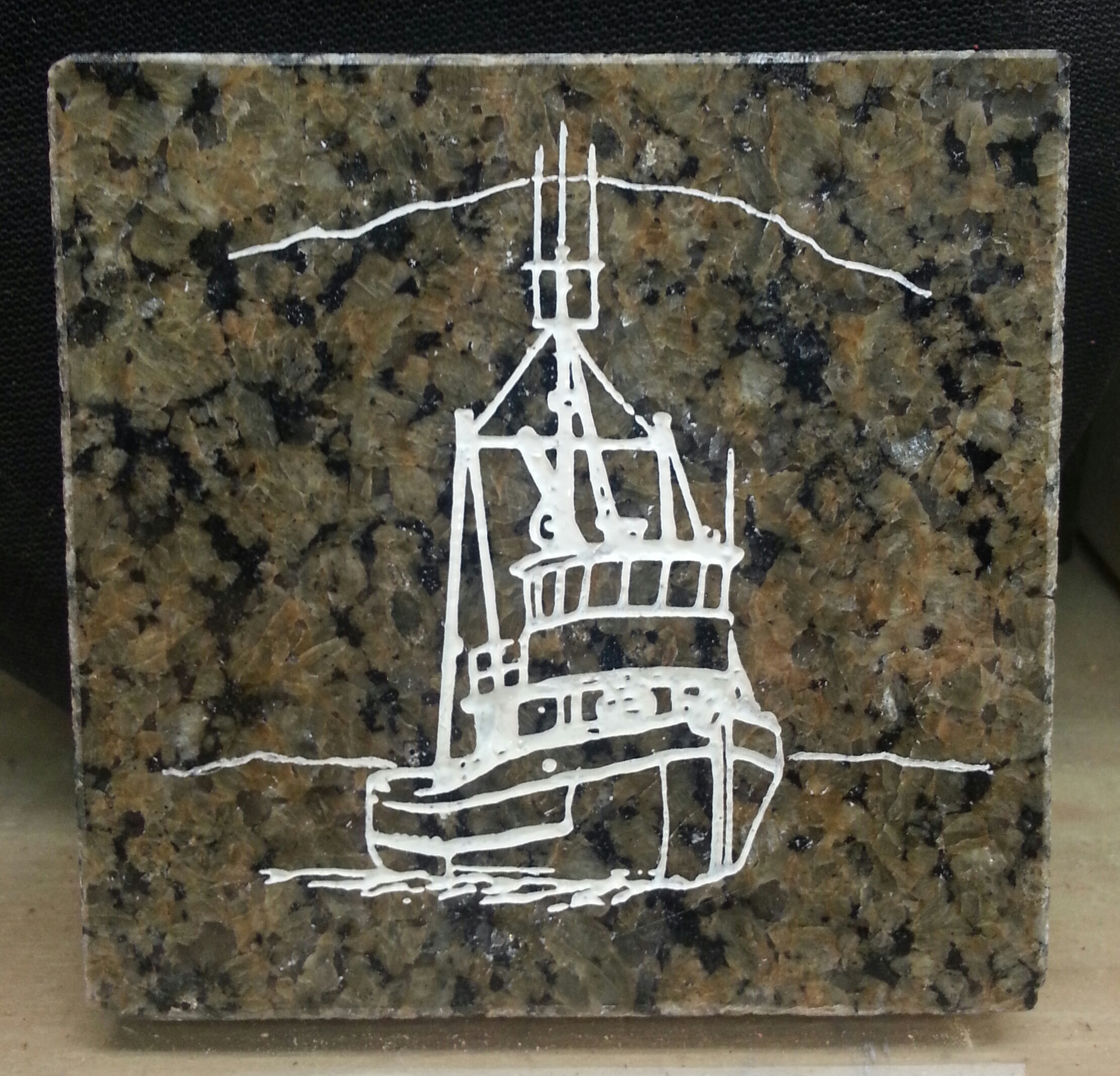 Hand engraved Seine boat on a 4x4 granite coffee coaster... not a cheap laser imitation... $25.00