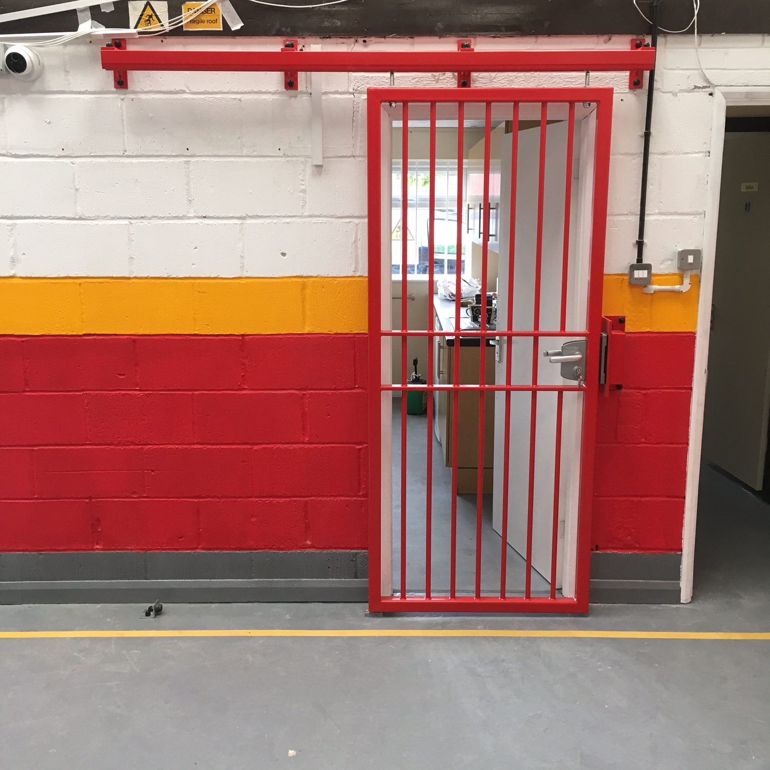 A 'jail style' door created for a clients office to make it more secure when not being occupied.