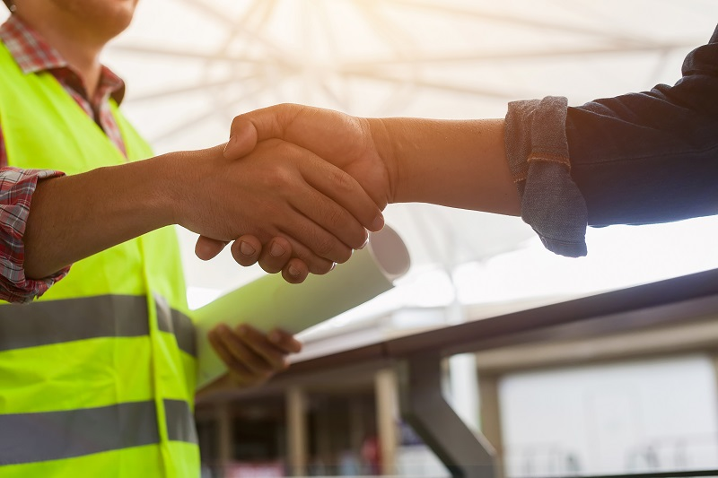Roofing Contractor and Homeowner Shaking Hands