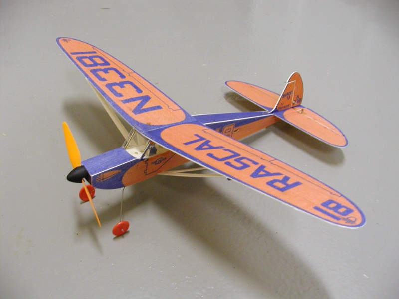 "Here is the finished model that was developed using the described process. This is a reproduction of a 1950's kit from Top Flite called  the Rascal 18. It was intended for rubber powered free flight operation. The model shown has an 18"" wing span and is equipped with an M-20, 4.2:1 gear drive, single 190 mah Lithium Polymer cell, JMP Combo radio, and two Bob Selman magnetic actuators. Flying weight is 30 grams."