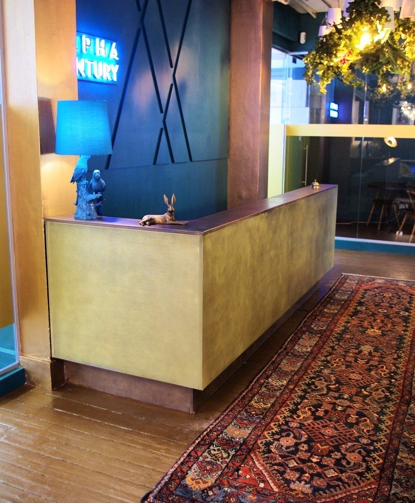 Bronze reception desk, bronze & brass metal finished by Artistic Metals.