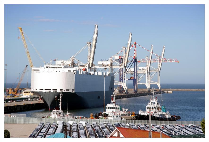 Car carrier in harbor||||