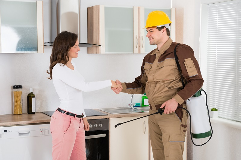 Pest Control Expert Shaking Hands with Homeowner