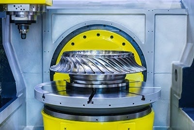 High-Precision CNC Machine Processes Steel Turbine Wheel