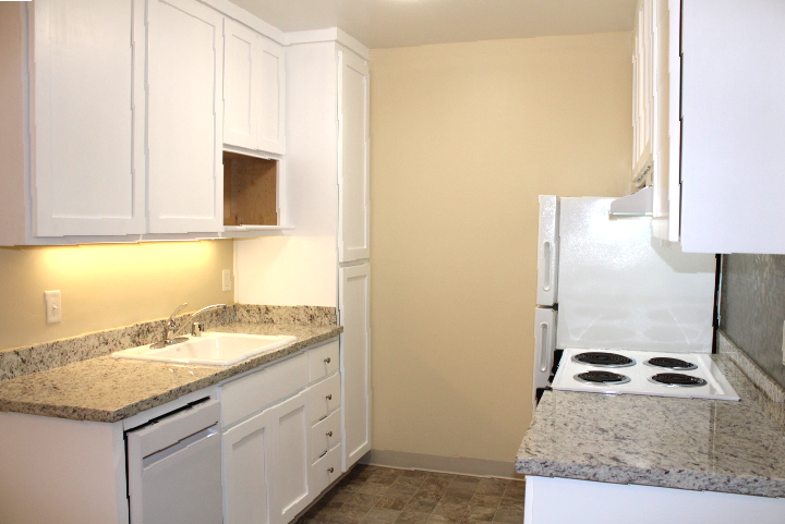 The kitchen has new, granite countertops and a new dishwasher.