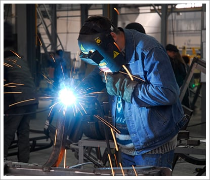 Welding operator holding his mask||||