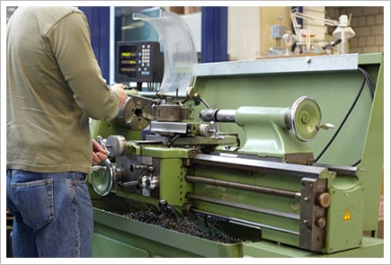 Man working on lathe||||