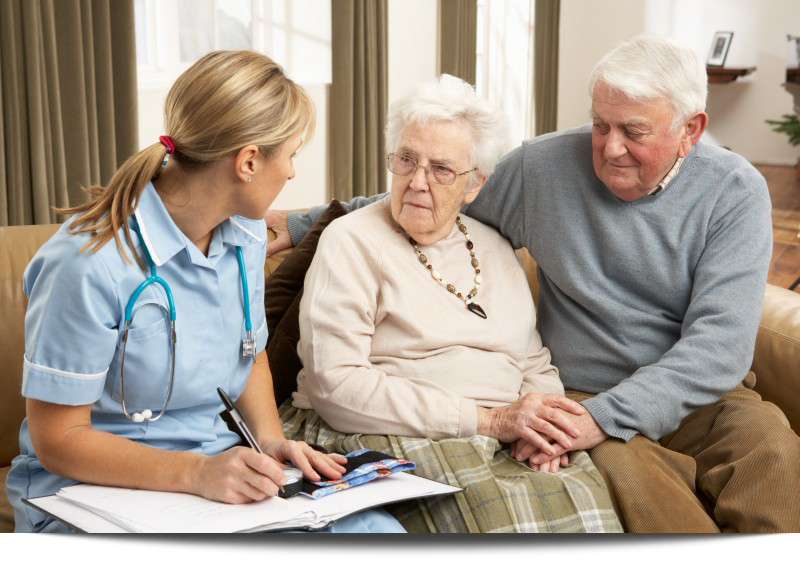 Senior Couple In Discussion With Health Professional||||