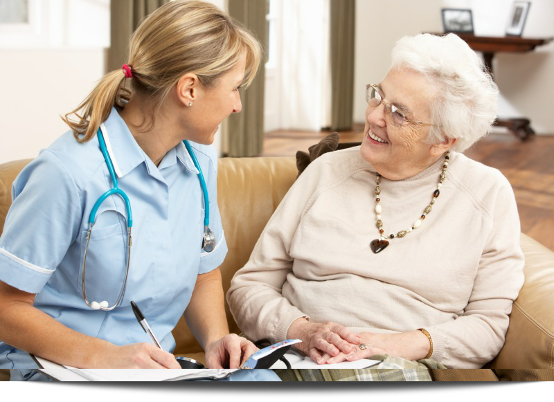 Senior Woman In Discussion With Health Professional    