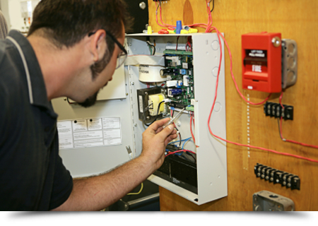 Electrician wiring a fire alarm||||