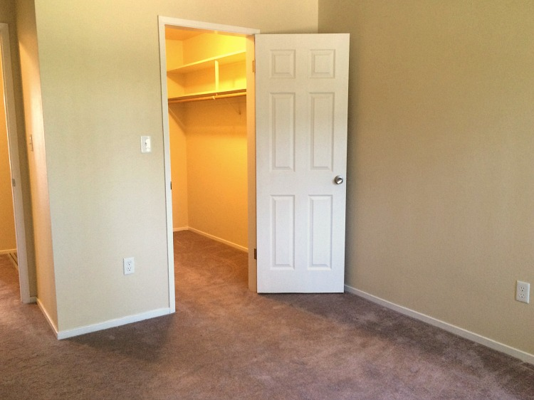 The first bedroom has a walk-in closet