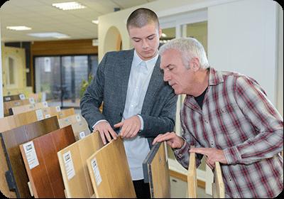 Men Looking at Flooring Samples in Store