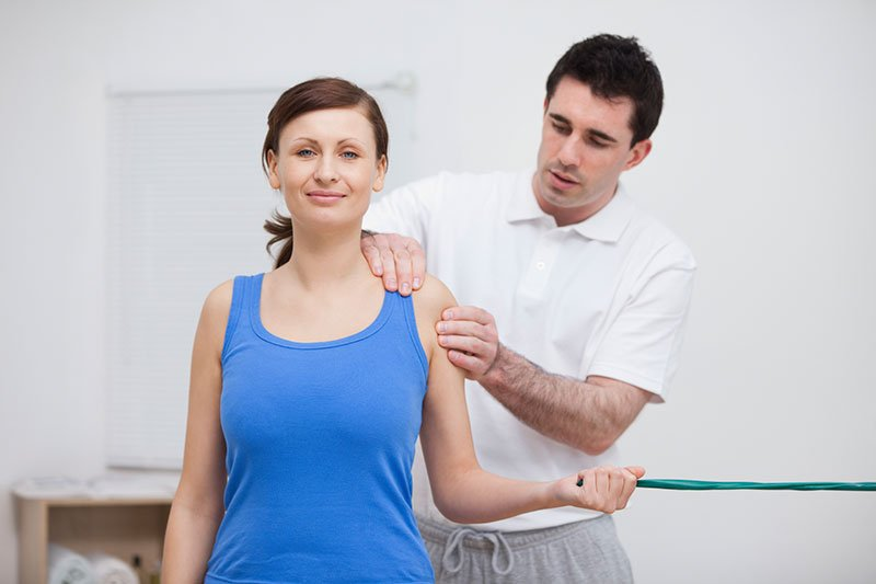 Woman being massaged by a physiotherapist
