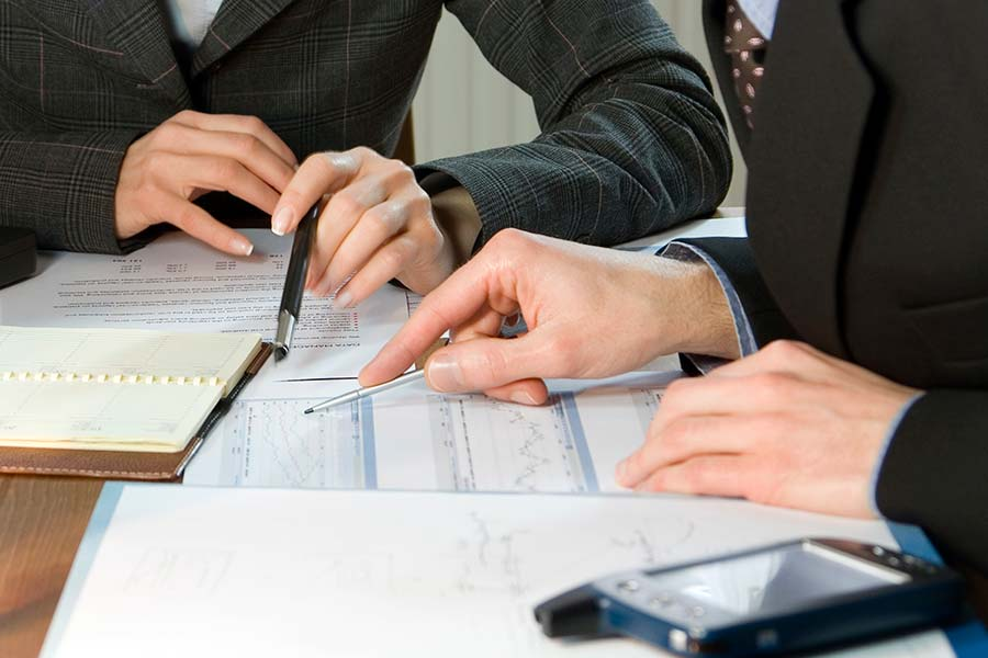 Man and woman preparing tax form