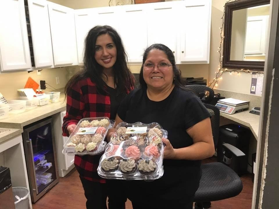 Two Women With Two Cupcake Boxes