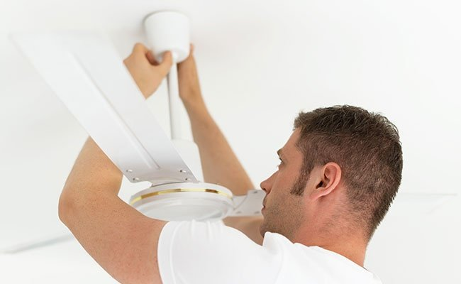 Male Technician Installing Ceiling Fan