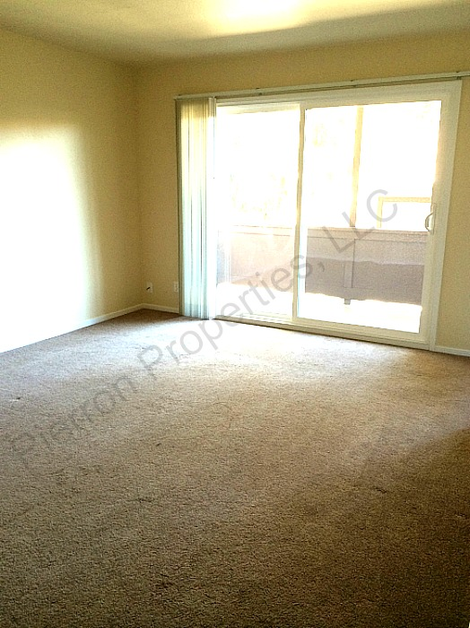 The family room, like this apartment, also has a private balcony.