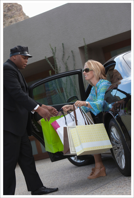 Chauffeur helping woman with bags||||