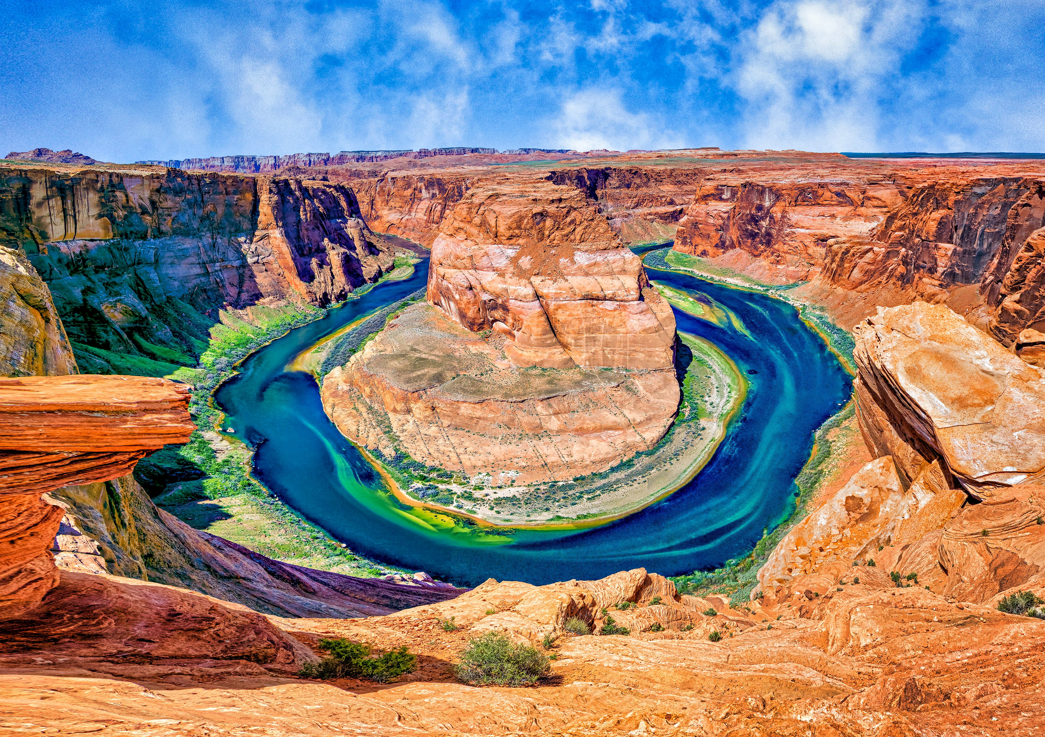 HORSESHOE BEND - A unique bend in the Colorado River near Page, AZ. It's a 1000 foot drop from the overlook down to the river.
