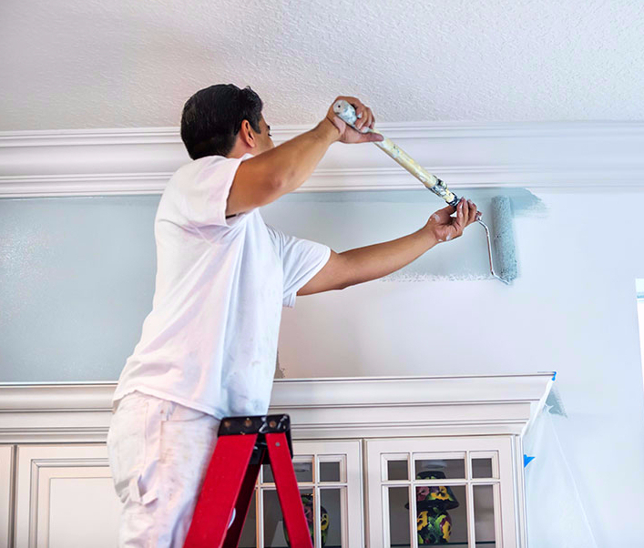 Painter painting home interior
