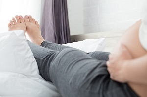 Pregnant woman elevating feet