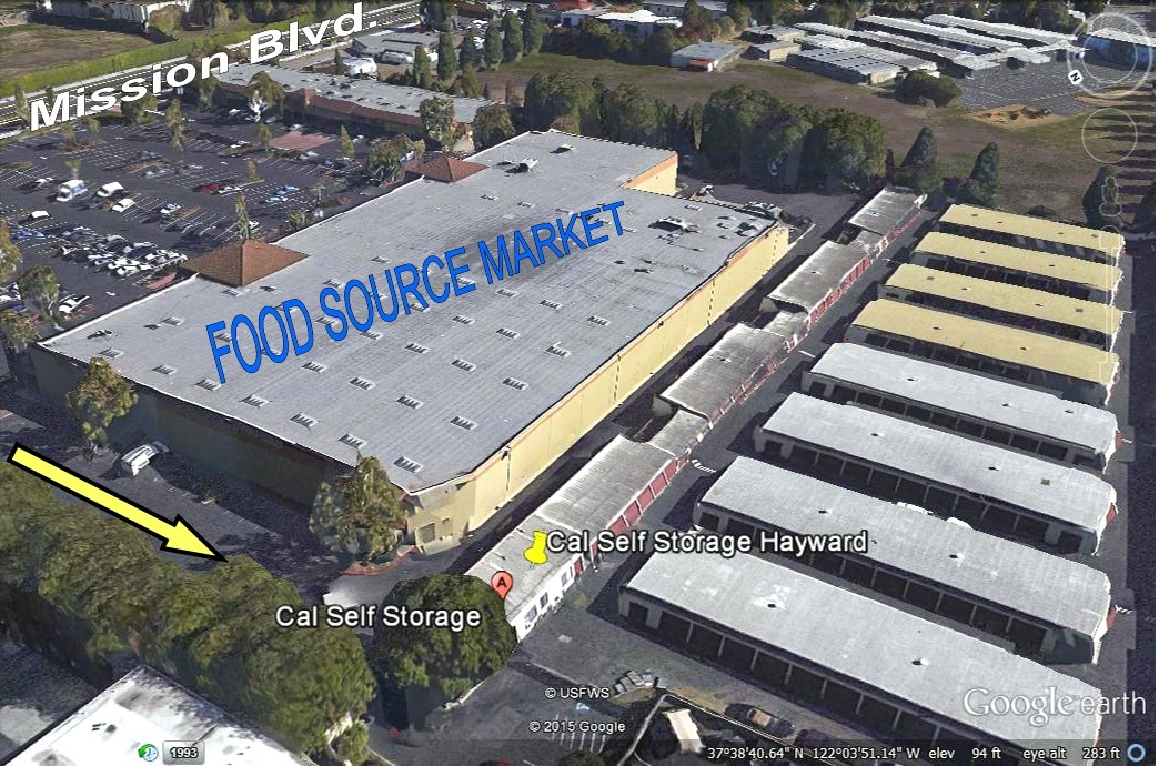 Cal Self Storage behind Food Source Market, aerial view