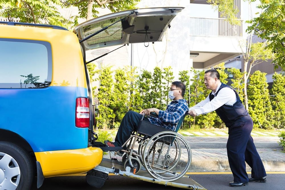 milwaukee transportation companies providing support for people in wheelchairs needing transportation services, going up vehicle accessible van.