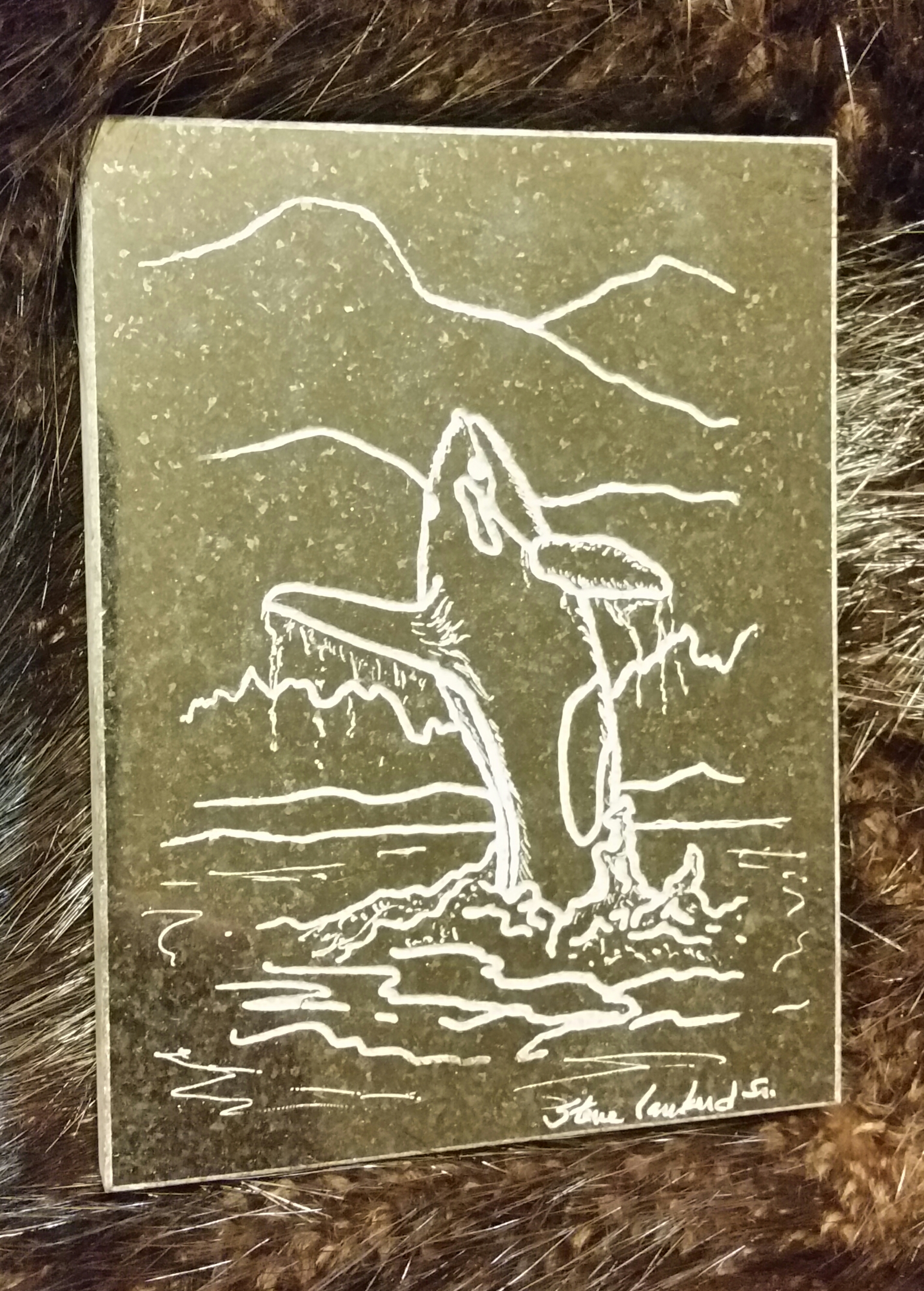 Hand engraved killer whale on a granite coaster... $25.00