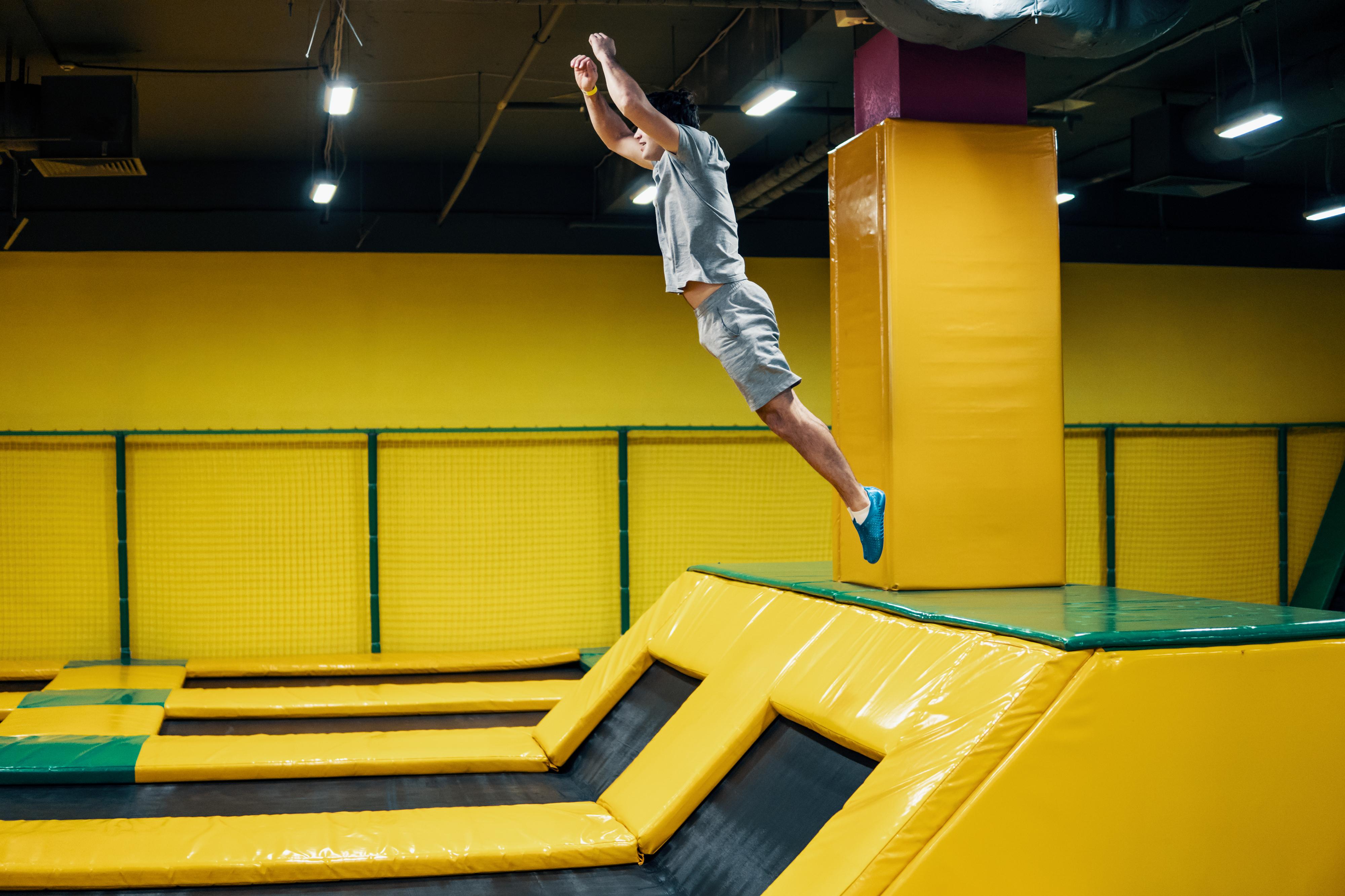 Man in an indoor trampoline park
