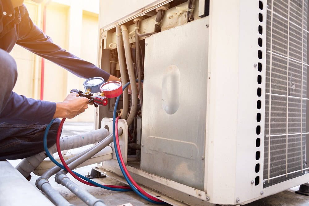 Technician checking residential HVAC system