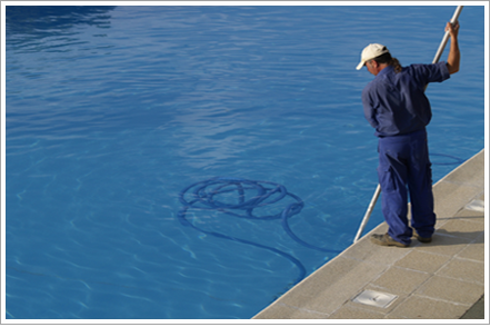 Worker cleaning a swimming pool||||