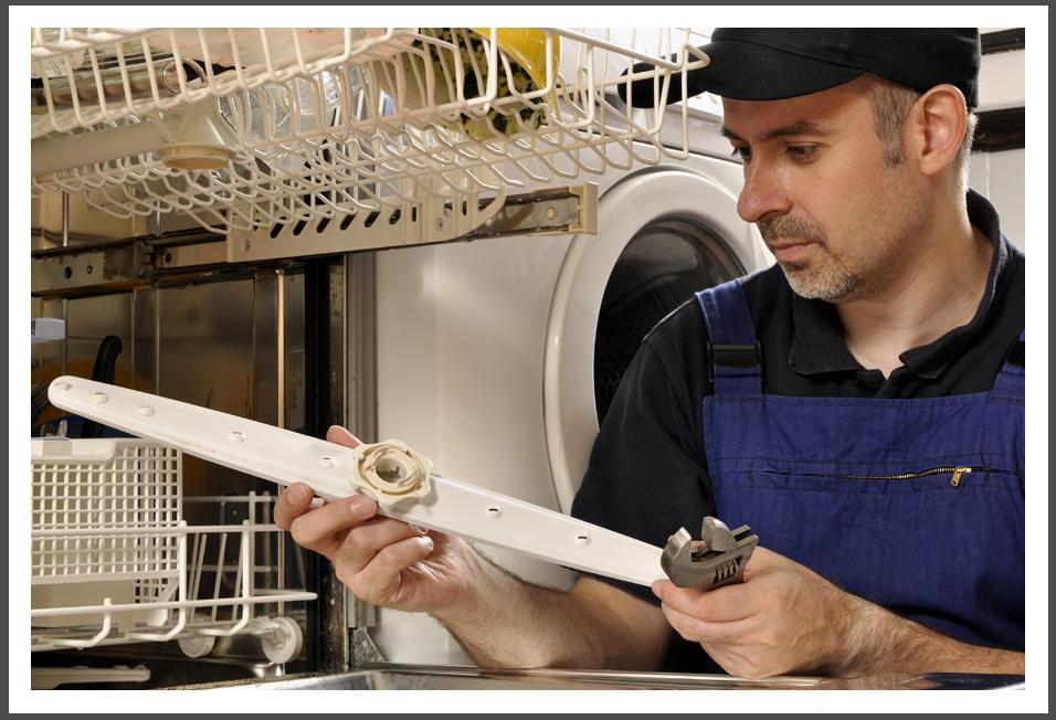 Man fixing dish washer||||