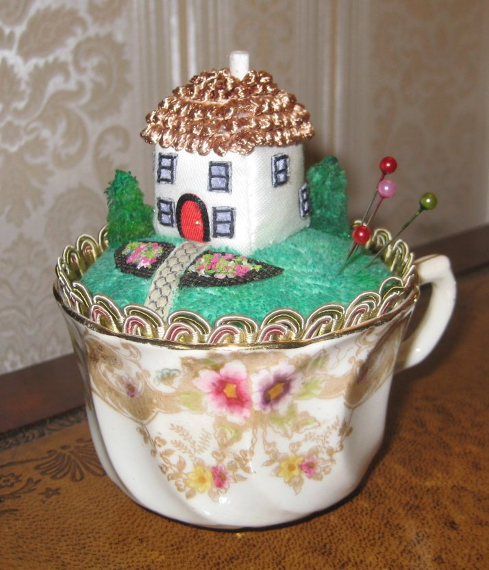 VINTAGE TEACUP PINCUSHION WITH MINIATURE COTTAGE SCENE