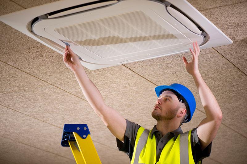 Man installing air conditioner