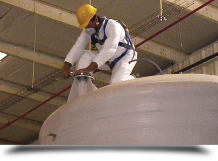 Worker on top of tank||||