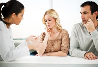 Unhappy couple taking counselling