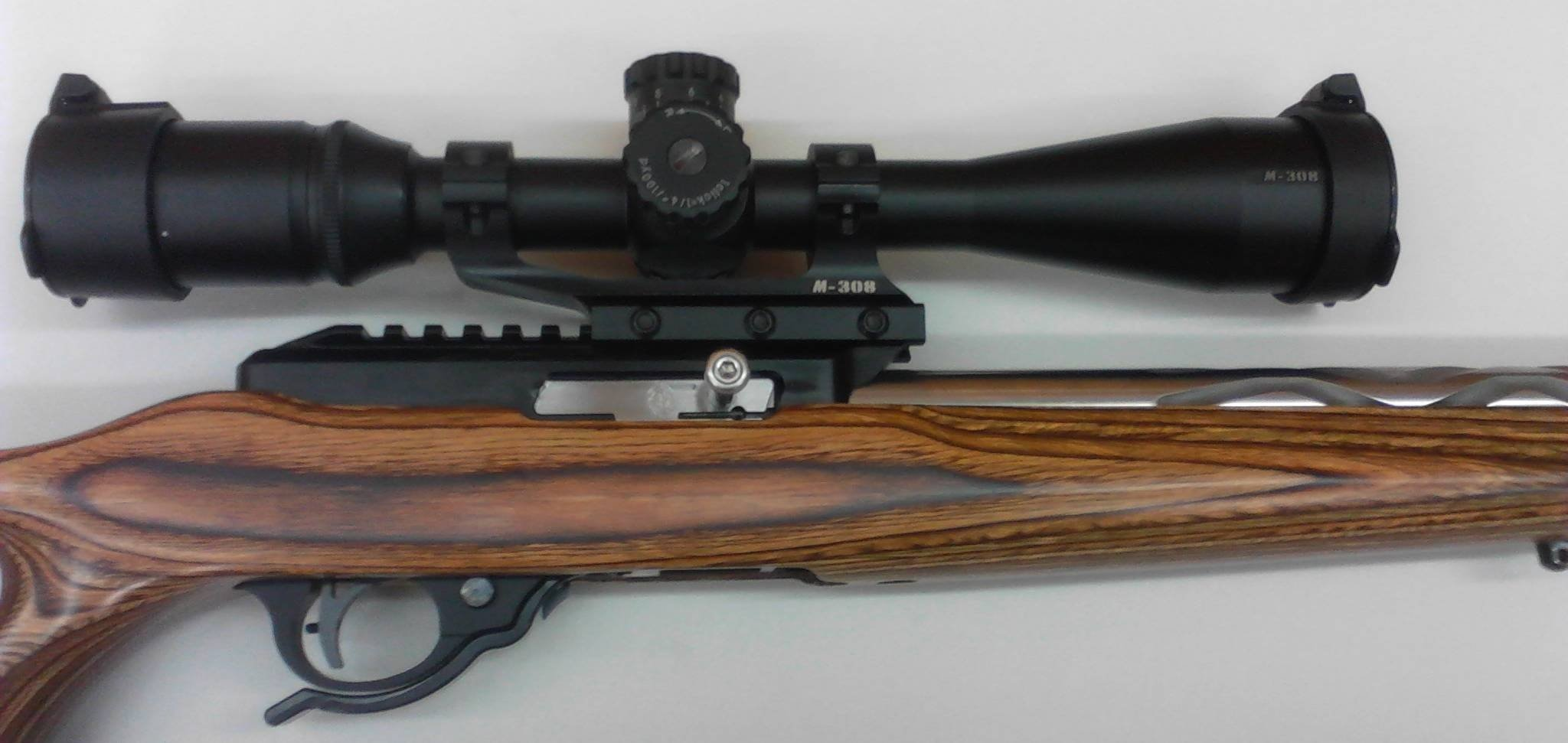 A custom ruger 10/22 with tactical solutions receiver, and Volquartsen snake fluted barrel