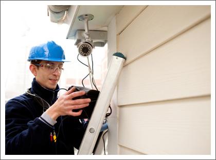Man repairing surveillance camera||||
