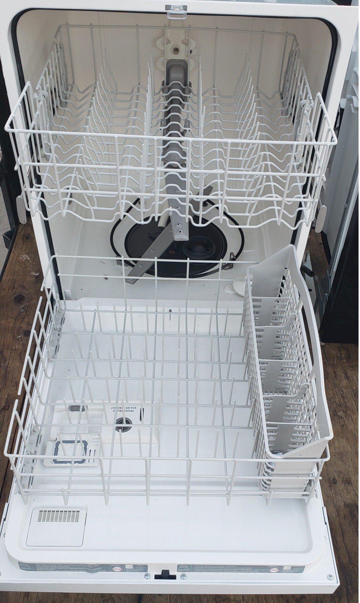 1 White Whirlpool Dishwasher inside