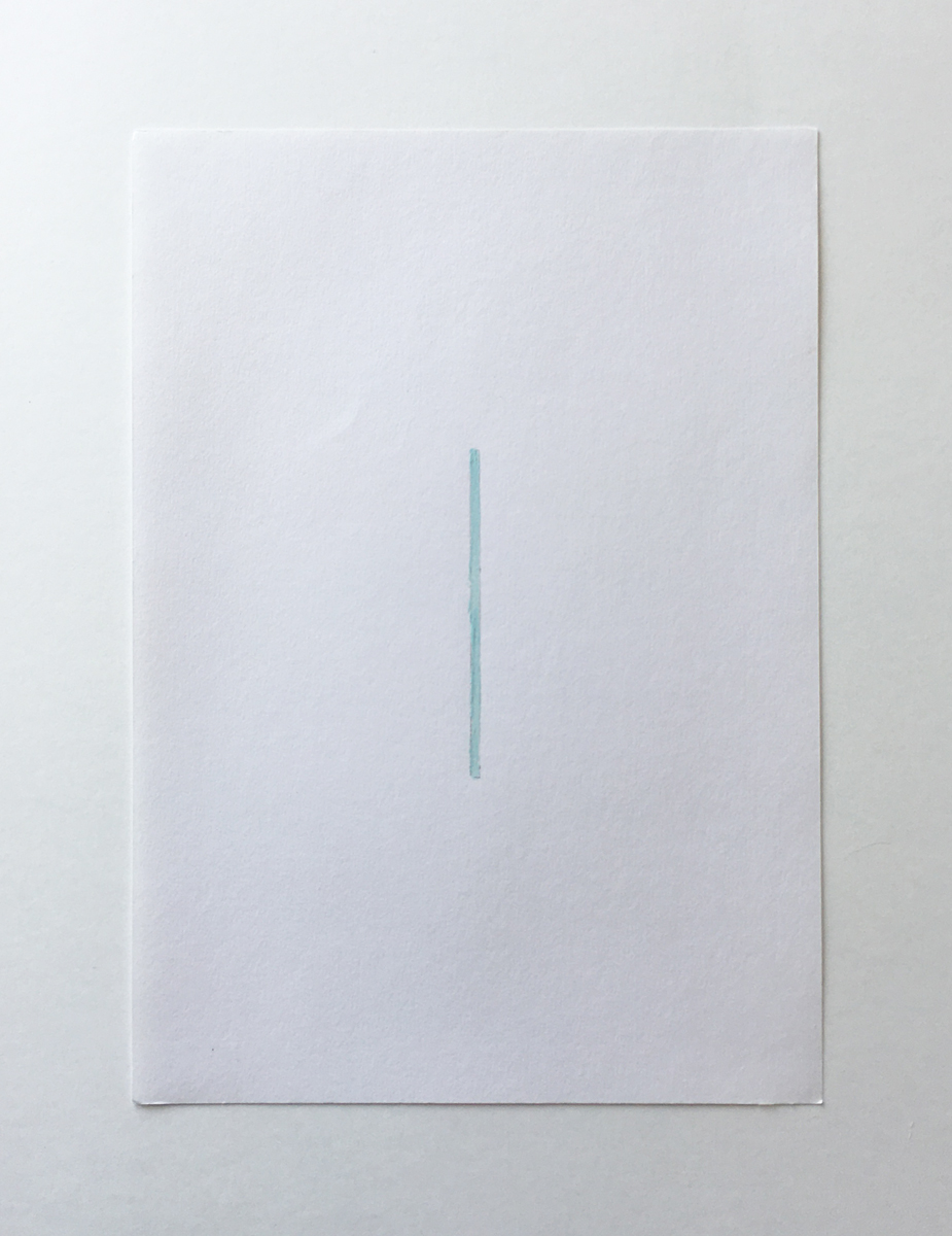 A white piece of paper with a thin straight line of light blue paint in the middle.