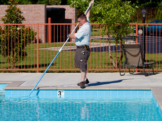 Worker Cleaning Swimming Pool