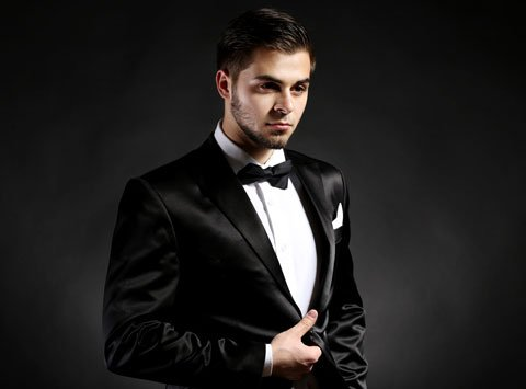 Elegant Man in Suit on Dark Background