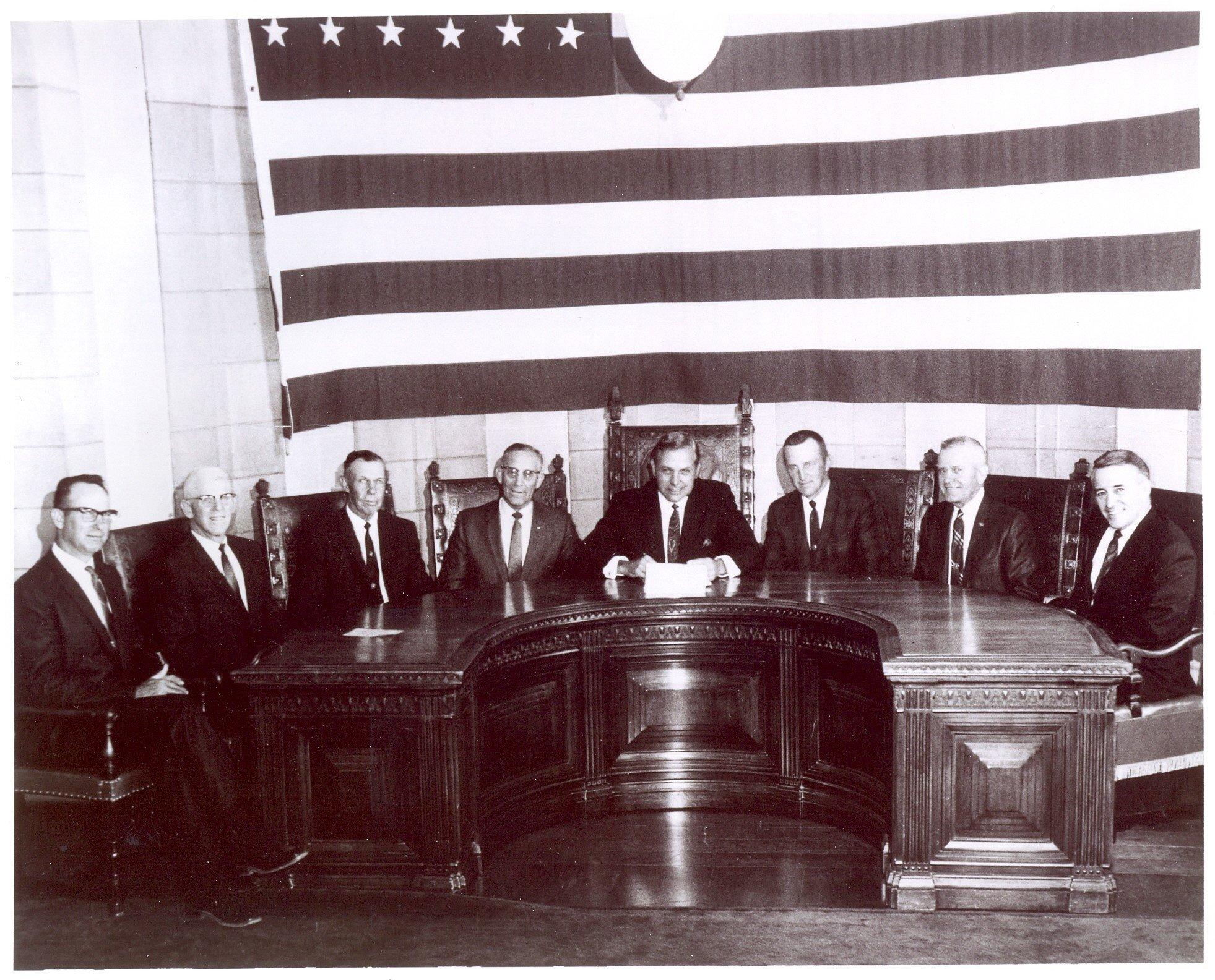 From left:  Harold Siek, Herman Link, Chet Ellis, Senator Maurice Kremer, Governor Tiemann, Warren Patefield, Milton Fricke, and Warren Fairchild.