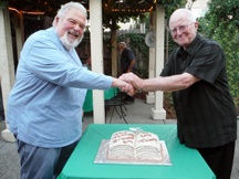 Sargent Thurber Reynolds (L) and Louis Evan Grivetti celebrate publication of their trilogy.