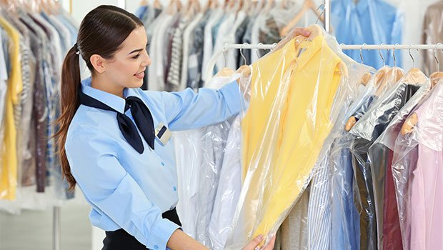 Female Worker in Dry-Cleaning Shop