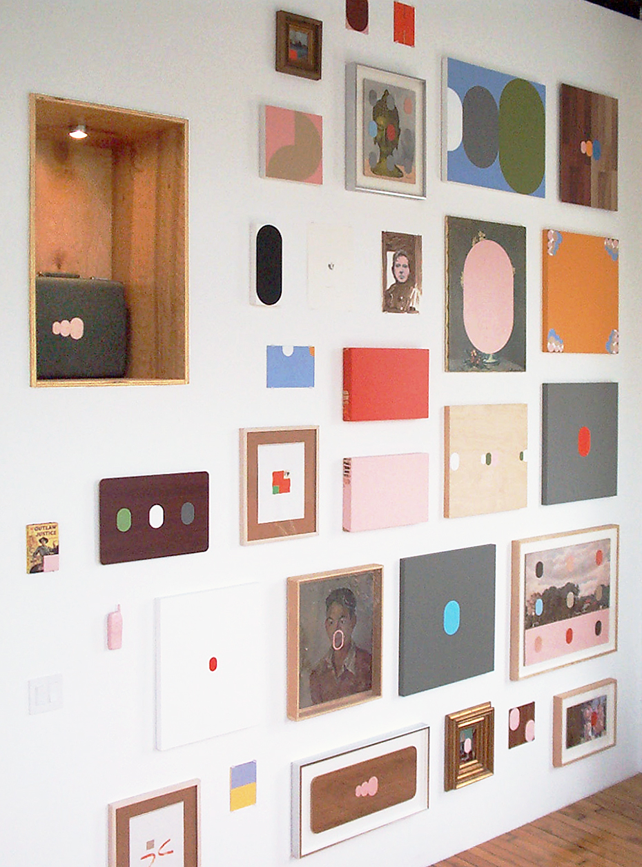 A wall of contemporary paintings and drawings, some abstract, some figurative.