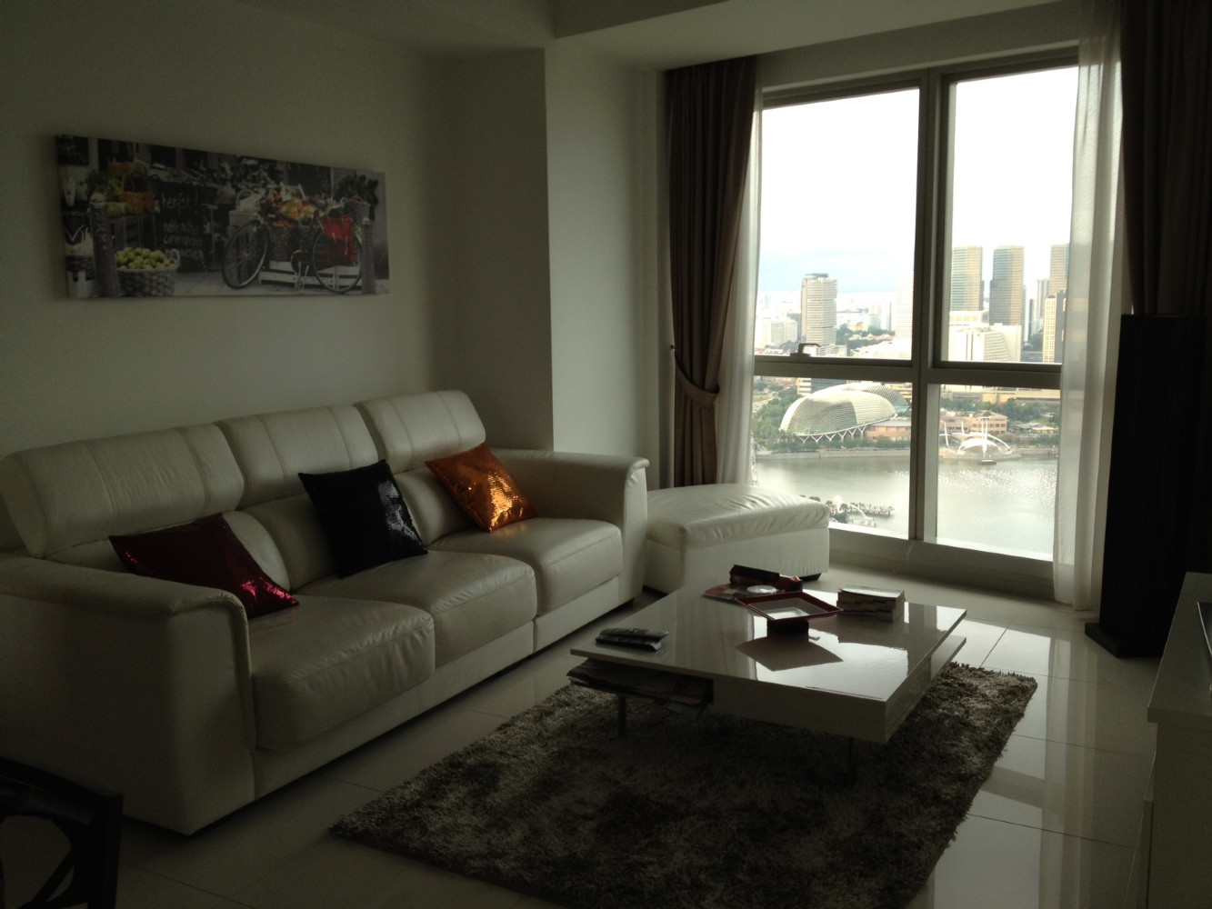 Awesome living room, luxury leather furniture in your Marina Bay Serviced Apartment