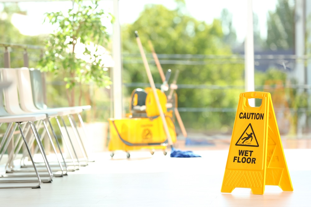 Wet floor sign and mop bucket in waiting room
